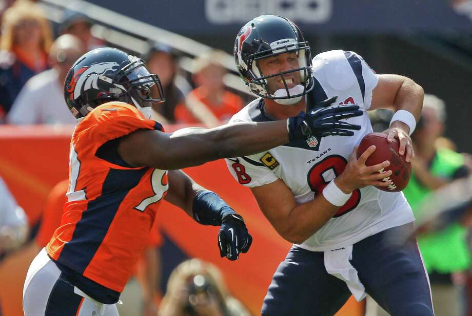 Denver Broncos defensive end Elvis Dumervil (92) sacks Houston Texans quarterback Matt Schaub (8) in the endzone for a safety during the first quarter of an NFL football game Sunday, Sept. 23, 2012, in Denver. (AP Photo/David Zalubowski) Photo: David Zalubowski, Associated Press / AP