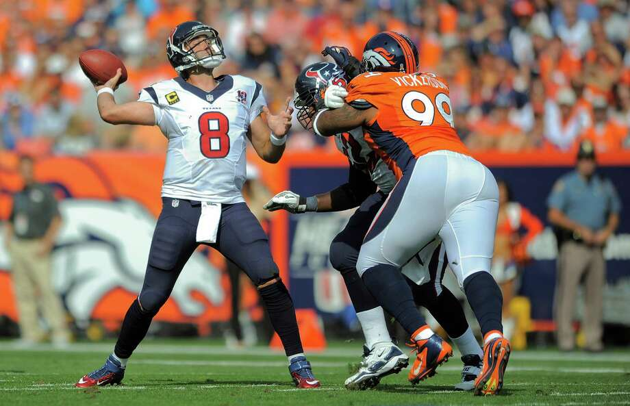 Houston Texans quarterback Matt Schaub (8) throws for a touchdown against the Denver Broncos in the second quarter of an NFL football game Sunday, Sept. 23, 2012, in Denver. (AP Photo/Jack Dempsey) Photo: Jack Dempsey, Associated Press / FR42408 AP