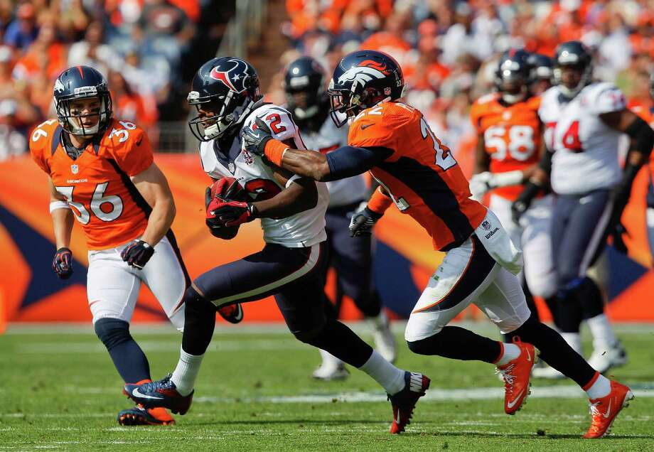 Houston Texans wide receiver Keshawn Martin (82) catches a pass against Denver Broncos cornerback Tracy Porter (22) in the second quarter of an NFL football game Sunday, Sept. 23, 2012, in Denver. (AP Photo/David Zalubowski) Photo: David Zalubowski, Associated Press / AP