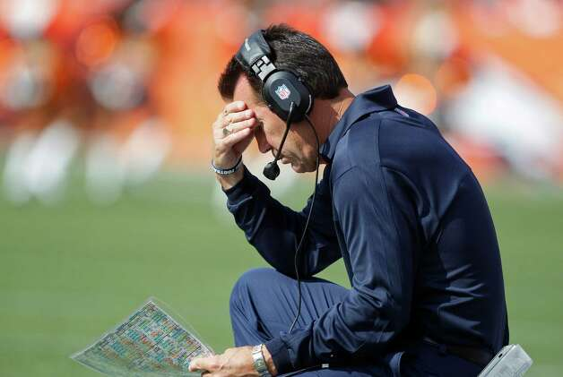 Houston Texans coach Gary Kubiak looks at a play sheet in the second quarter of an NFL football game against the Denver Broncos, Sunday, Sept. 23, 2012, in Denver. (AP Photo/David Zalubowski) Photo: David Zalubowski, Associated Press / AP