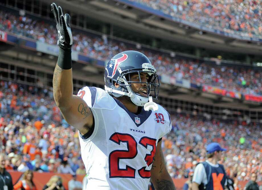 Houston Texans running back Arian Foster (23) reacts after scoring a touchdown against the Denver Broncos in the first quarter of an NFL football game Sunday, Sept. 23, 2012, in Denver. (AP Photo/Jack Dempsey) Photo: Jack Dempsey, Associated Press / FR42408