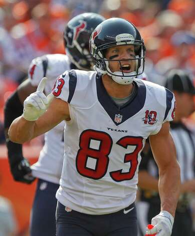 Houston Texans wide receiver Kevin Walter (83) reacts after scoring a touchdown against the Denver Broncos in the second quarter of an NFL football game Sunday, Sept. 23, 2012, in Denver. (AP Photo/David Zalubowski) Photo: David Zalubowski, Associated Press / AP