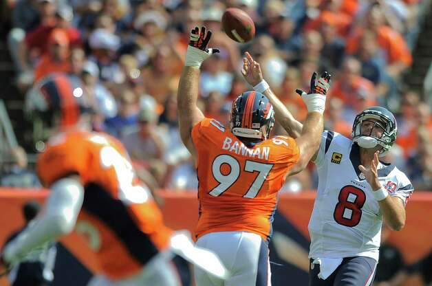 Houston Texans quarterback Matt Schaub (8) throws over Denver Broncos defensive tackle Justin Bannan (97) for a touchdown in the first quarter of an NFL football game Sunday, Sept. 23, 2012, in Denver. (AP Photo/Jack Dempsey) Photo: Jack Dempsey, Associated Press / FR42408 AP