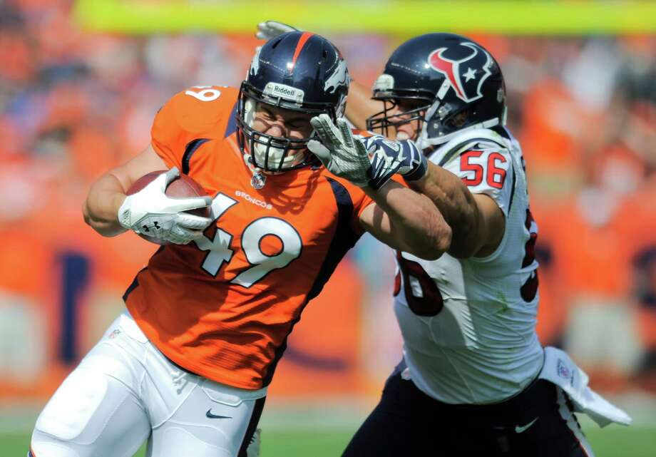 Denver Broncos running back Chris Gronkowski (49) is tackled by Houston Texans inside linebacker Brian Cushing (56) in the first quarter of an NFL football game Sunday, Sept. 23, 2012, in Denver. (AP Photo/Jack Dempsey) Photo: Jack Dempsey, Associated Press / FR42408 AP