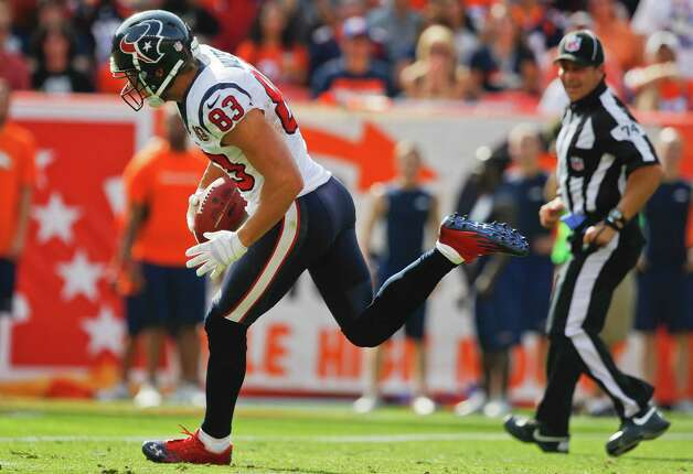 Houston Texans wide receiver Kevin Walter (83) comes down with a pass for a touchdown against the Denver Broncos in the second quarter of an NFL football game Sunday, Sept. 23, 2012, in Denver. (AP Photo/David Zalubowski) Photo: David Zalubowski, Associated Press / AP