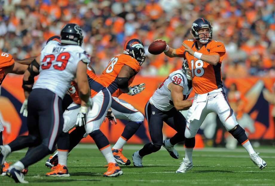 Denver Broncos quarterback Peyton Manning (18) throws against the Houston Texans in the first quarter of an NFL football game Sunday, Sept. 23, 2012, in Denver. (AP Photo/Jack Dempsey) Photo: Jack Dempsey, Associated Press / FR42408 AP