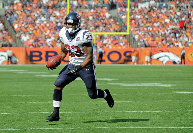 Houston Texans running back Arian Foster (23) runs for a touchdown against the Denver Broncos in the first quarter of an NFL football game Sunday, Sept. 23, 2012, in Denver. (AP Photo/Jack Dempsey) Photo: Jack Dempsey, Associated Press / FR42408