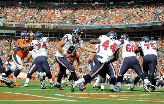 Houston Texans quarterback Matt Schaub (8) hands off the ball to Houston Texans running back Ben Tate (44) in the first quarter of an NFL football game against the Denver Broncos, Sunday, Sept. 23, 2012, in Denver. (AP Photo/Jack Dempsey) Photo: Jack Dempsey, Associated Press / FR42408
