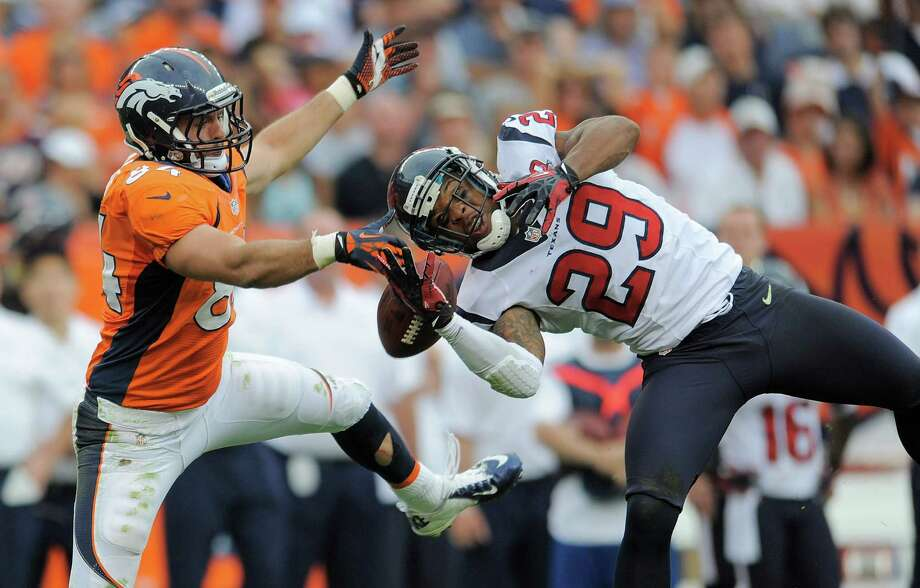 Denver Broncos tight end Jacob Tamme (84) breaks up a pass intended for Houston Texans strong safety Glover Quin (29) in the fourth quarter of an NFL football game Sunday, Sept. 23, 2012, in Denver. (AP Photo/Jack Dempsey) Photo: Jack Dempsey, Associated Press / FR42408 AP