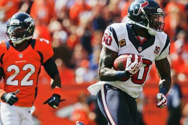 Houston Texans wide receiver Andre Johnson (80) catches a pass for a touchdown as Denver Broncos cornerback Tracy Porter (22) pursues in the first quarter of an NFL football game Sunday, Sept. 23, 2012, in Denver. (AP Photo/David Zalubowski) Photo: David Zalubowski, Associated Press / AP