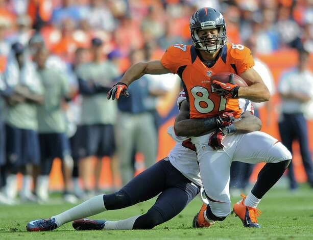 Denver Broncos wide receiver Eric Decker (87) is tackled by Houston Texans cornerback Kareem Jackson (25) after catching a pass in the third quarter of an NFL football game Sunday, Sept. 23, 2012, in Denver. (AP Photo/Jack Dempsey) Photo: Jack Dempsey, Associated Press / FR42408 AP