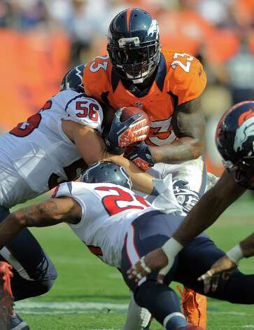 Denver Broncos running back Willis McGahee (23) is hit by Houston Texans inside linebacker Brian Cushing (56) and strong safety Glover Quin (29) in the second quarter of an NFL football game Sunday, Sept. 23, 2012, in Denver. (AP Photo/Jack Dempsey) Photo: Jack Dempsey, Associated Press / FR42408 AP