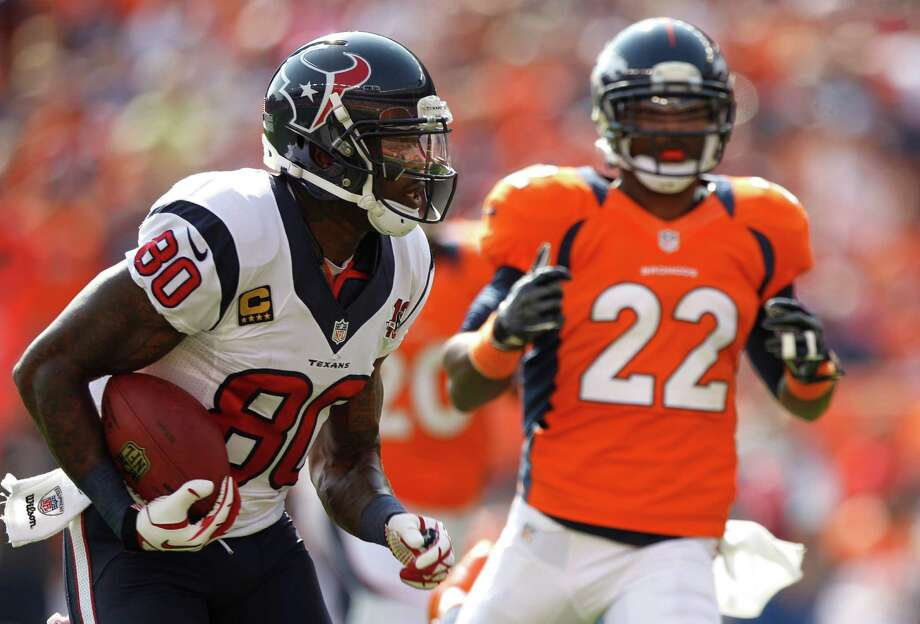 Houston Texans wide receiver Andre Johnson (80) runs past Denver Broncos cornerback Tracy Porter (22) on his way to a 60-yard touchdown reception during the first quarter at Sports Authority Field Sunday, Sept. 23, 2012, in Denver. The Texans beat the Broncos 31-25. Photo: Brett Coomer, Houston Chronicle / © 2012  Houston Chronicle