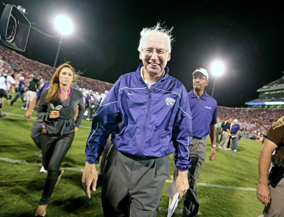 Normally dour Kansas State coach Bill Snyder allows himself a well-deserved smile as he leaves the field after his Wildcats upset Oklahoma on Saturday. Photo: Brett Deering / 2012 Getty Images