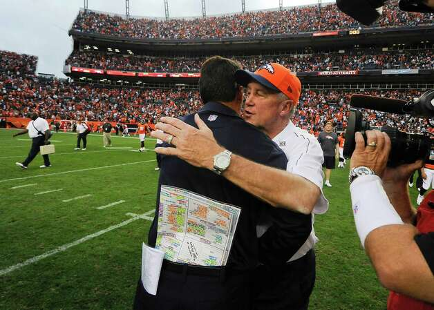 Denver Broncos coach John Fox, right, greets Houston Texans coach Gary Kubiak after an NFL football game Sunday, Sept. 23, 2012, in Denver. Houston won 31-25. (AP Photo/Jack Dempsey) Photo: Jack Dempsey, Associated Press / FR42408