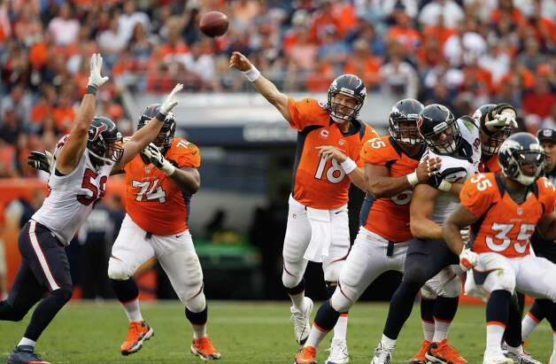 Denver Broncos quarterback Peyton Manning (18) passes against the Houston Texans during the fourth quarter of an NFL football game Sunday, Sept. 23, 2012, in Denver. (AP Photo/David Zalubowski) Photo: David Zalubowski, Associated Press / AP