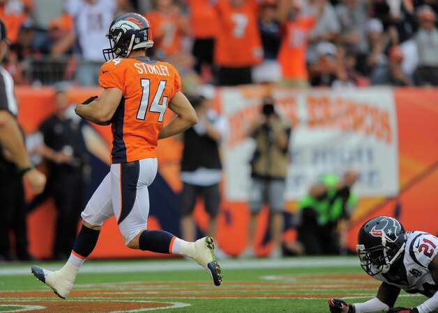 Denver Broncos wide receiver Brandon Stokley (14) runs for a touchdown as Houston Texans defensive back Brice McCain (21) looks on in the fourth quarter of an NFL football game Sunday, Sept. 23, 2012, in Denver. (AP Photo/Jack Dempsey) Photo: Jack Dempsey, Associated Press / FR42408 AP