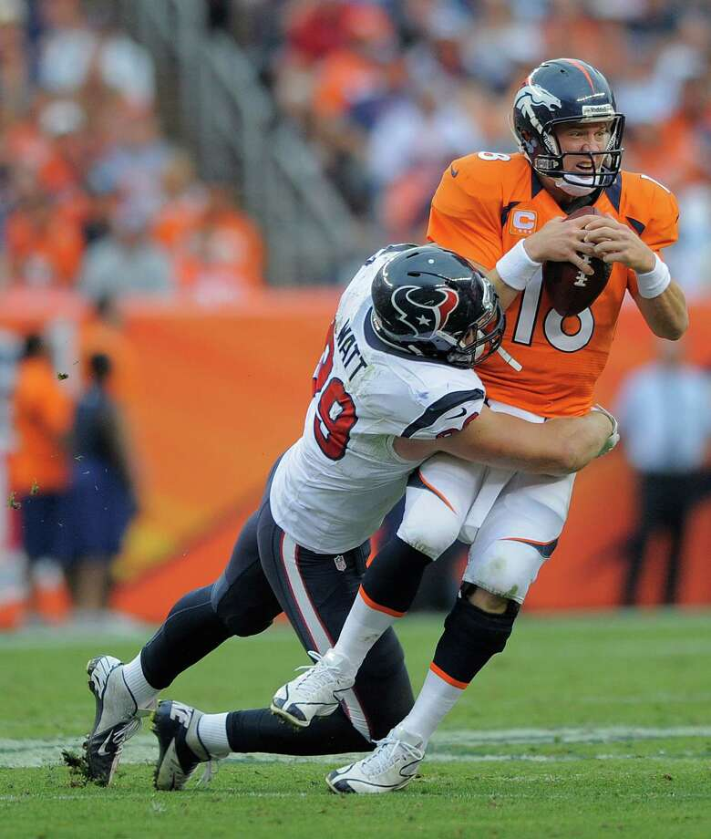 Denver Broncos quarterback Peyton Manning (18) is sacked by Houston Texans defensive end J.J. Watt (99) in the fourth quarter of an NFL football game Sunday, Sept. 23, 2012, in Denver. (AP Photo/Jack Dempsey) Photo: Jack Dempsey, Associated Press / FR42408 AP