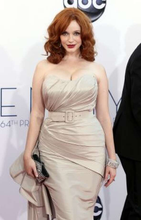Christina Hendricks arrives at the 64th Primetime Emmy Awards at the Nokia Theatre on Sunday, Sept. 23, 2012, in Los Angeles.  (Matt Sayles / Associated Press)