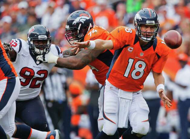 Denver Broncos quarterback Peyton Manning (18) makes a lateral pass against the Houston Texans in the fourth quarter of an NFL football game Sunday, Sept. 23, 2012, in Denver. (AP Photo/David Zalubowski) Photo: David Zalubowski, Associated Press / AP