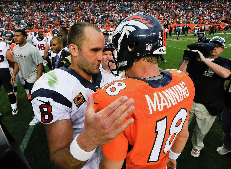 Houston Texans quarterback Matt Schaub (8) talks with Denver Broncos quarterback Peyton Manning (18) after an NFL football game Sunday, Sept. 23, 2012, in Denver. Houston won 31-25. (AP Photo/Jack Dempsey) Photo: Jack Dempsey, Associated Press / FR42408