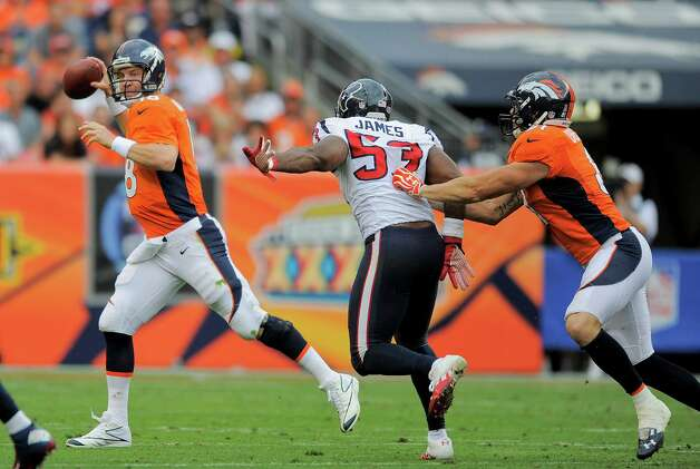 Denver Broncos quarterback Peyton Manning (18) throws on the run as Houston Texans inside linebacker Bradie James (53) rushes the pass in the fourth quarter of an NFL football game Sunday, Sept. 23, 2012, in Denver. (AP Photo/Jack Dempsey) Photo: Jack Dempsey, Associated Press / FR42408 AP