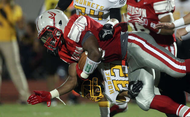 Judson's Jarveon Williams (02) gets tackled by East Central's Dennis Chavez (32) during their game at D.W. Rutledge Stadium on Friday, Sept. 21, 2012. Photo: Kin Man Hui, Express-News / ©2012 San Antonio Express-News