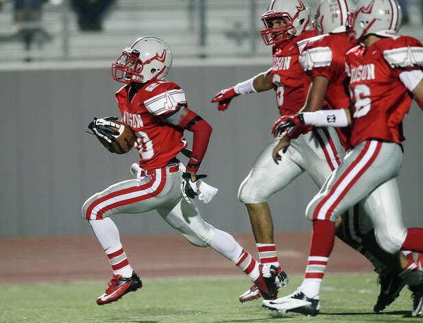 Judson's Brandon Sanders (20) cruises to a touchdown followed by teammates after breaking several East Central tackles for a 43-yard touchdown at D.W. Rutledge Stadium on Friday, Sept. 21, 2012. Photo: Kin Man Hui, Express-News / ©2012 San Antonio Express-News