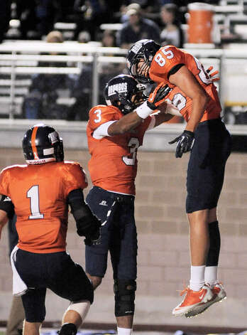 Brandeis' Andrew Heft (85) celebrates a touchdown reception with teammates Jonathan Robinson (3) and Trinton Ynclan during the first half of a high school football game against O'Connor, Friday, Sept. 21, 2012, Farris Stadium in San Antonio. Photo: Darren Abate, Express-News