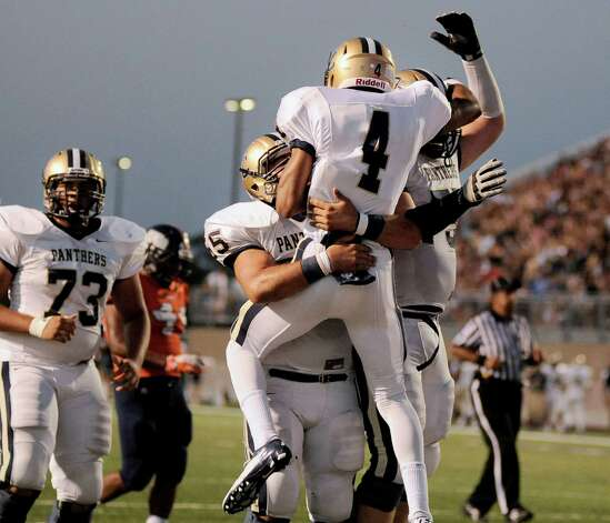 O'Connor wide receiver Nate Phillips (4) celebrates a touchdown with teammates during the first half of a high school football game against Brandeis, Friday, Sept. 21, 2012, Farris Stadium in San Antonio. Photo: Darren Abate, Express-News