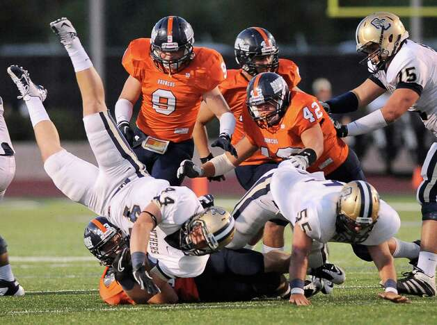 O'Connor running back Billy Craft (44) is brought down by Brandeis' Cameron Rogers (43) during the first half of a high school football game, Friday, Sept. 21, 2012, Farris Stadium in San Antonio. Photo: Darren Abate, Express-News