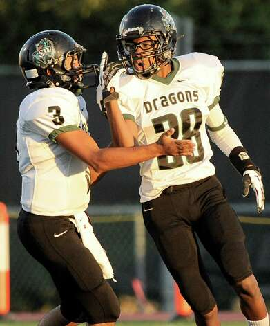 Southwest running back Erin Mack, right, celebrates a touchdown with teammate Lorenzo Gonzalez during a high school football game against Brennan, Saturday, Sept. 22, 2012, at Farris Stadium in San Antonio. Photo: Darren Abate, Express-News