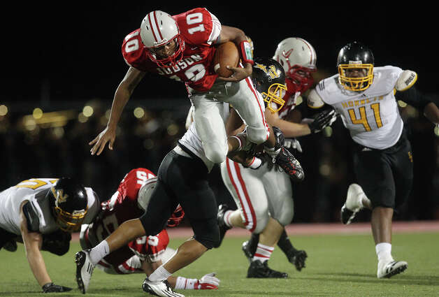 Judson quarterback Rayjohn Austin-Ramsey (10) gets airborne as he gets tackled by East Central's Dennis Chavez (32) during their game at D.W. Rutledge Stadium on Friday, Sept. 21, 2012. Photo: Kin Man Hui, Express-News / ©2012 San Antonio Express-News