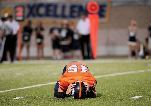 Brandeis quarterback Colbie Price recovers after a hit during the first half of a high school football game against O'Connor, Friday, Sept. 21, 2012, Farris Stadium in San Antonio. Photo: Darren Abate, Express-News