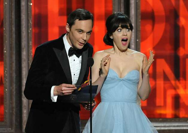 Jim Parsons, left, and Zooey Deschanel present an award onstage at the 64th Primetime Emmy Awards at the Nokia Theatre on Sunday, Sept. 23, 2012, in Los Angeles. (Photo by John Shearer/Invision/AP) Photo: John Shearer, Associated Press