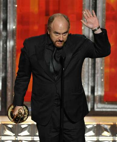 "Louis C.K. accepts the award for outstanding writing in a comedy series to for ""Louie"" at the 64th Primetime Emmy Awards at the Nokia Theatre on Sunday, Sept. 23, 2012, in Los Angeles. (Photo by John Shearer/Invision/AP) Photo: John Shearer, Associated Press"