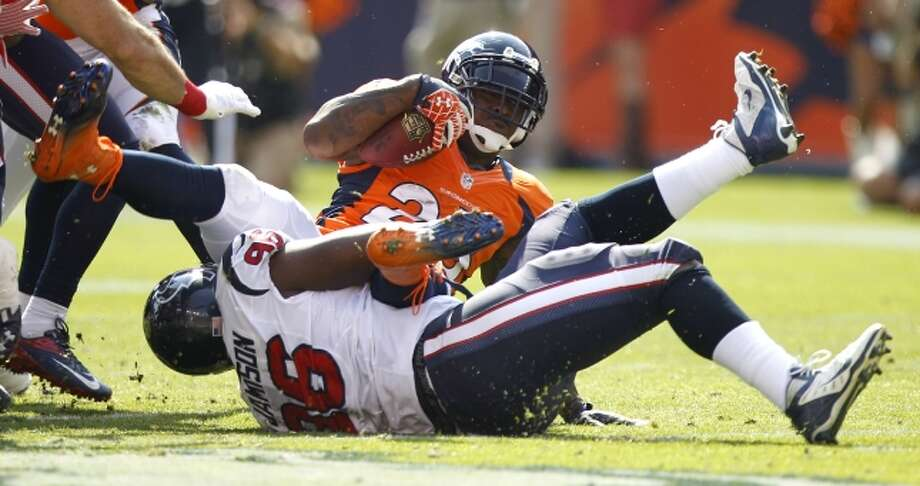 Texans defensive end Tim Jamison stops Broncos running back Willis McGahee at the line of scrimmage. (Brett Coomer / © 2012  Houston Chronicle)