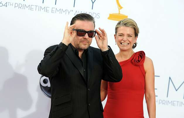 Actor Ricky Gervais, left and Jane Fallon arrive at the 64th Primetime Emmy Awards at the Nokia Theatre on Sunday, Sept. 23, 2012, in Los Angeles.  (Photo by Jordan Strauss/Invision/AP) Photo: Jordan Strauss, Associated Press