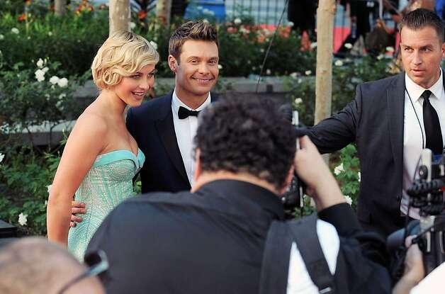 Actress Julianne Hough, left and TV personality Ryan Seacrest arrive at the 64th Primetime Emmy Awards at the Nokia Theatre on Sunday, Sept. 23, 2012, in Los Angeles.  (Photo by Jordan Strauss/Invision/AP) Photo: Jordan Strauss, Associated Press