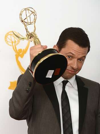 Actor John Cryer poses in the press room at the 64th annual Prime Time Emmy Awards at the Nokia Theatre at LA Live in Los Angeles, California September 23, 2012. Cryer won Outstanding Lead Actor for Two and a Half Men.    AFP PHOTO / JOE KLAMARJOE KLAMAR/AFP/GettyImages Photo: Joe Klamar, AFP/Getty Images