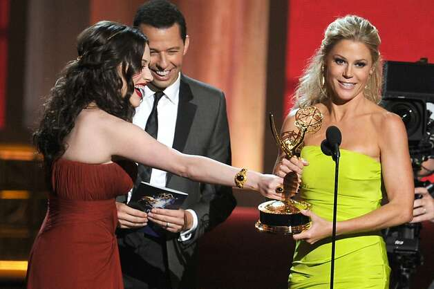 "Actress Julie Bowen (R) accepts Outstanding Supporting Actress in a Comedy Series award for ""Modern Family"" from actors Kat Dennings and Jon Cryer onstage during the 64th Annual Primetime Emmy Awards at Nokia Theatre L.A. Live on September 23, 2012 in Los Angeles, California.  (Photo by Kevin Winter/Getty Images) Photo: Kevin Winter, Getty Images"