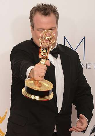 Eric Stonestreet poses in the press room with his Outstanding Supporting Actor award at the 64th annual Prime Time Emmy Awards at the Nokia Theatre at LA Live in Los Angeles, California September 23, 2012.  AFP PHOTO / JOE KLAMARJOE KLAMAR/AFP/GettyImages Photo: Joe Klamar, AFP/Getty Images