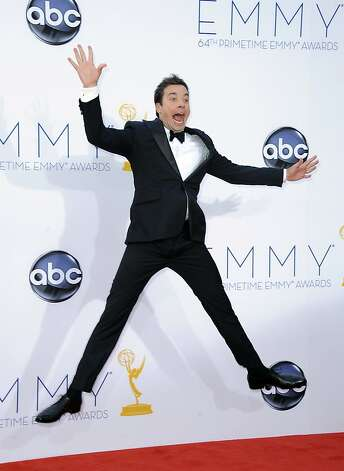 Jimmy Fallon arrives at the 64th Primetime Emmy Awards at the Nokia Theatre on Sunday, Sept. 23, 2012, in Los Angeles.  (Photo by Jordan Strauss/Invision/AP) Photo: Jordan Strauss, Associated Press