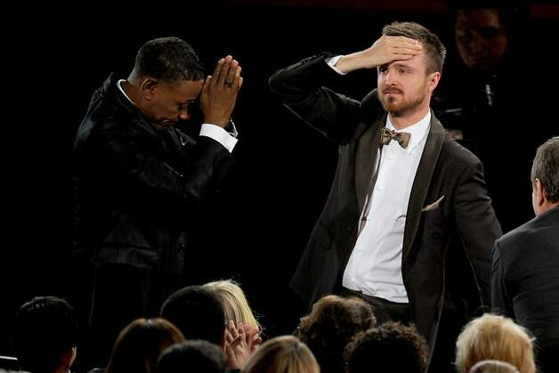 "Actor Giancarlo Esposito (L) salutes actor Aaron Paul (R), winner Outstanding Supporting Actor in a Drama Series award for ""Breaking Bad,"" during the 64th Annual Primetime Emmy Awards at Nokia Theatre L.A. Live on September 23, 2012 in Los Angeles, California.  (Photo by Kevin Winter/Getty Images) Photo: Kevin Winter, Getty Images"