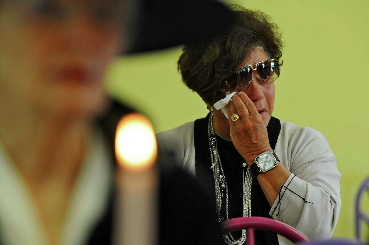 Anna Marie Matarazzo of Schenectady sheds a tear while holding a candle during A Day of Remembrance for Murder Victims, at Central Park, on Sunday Sept. 23, 2012 in Schenectady, NY. (Philip Kamrass / Times Union)