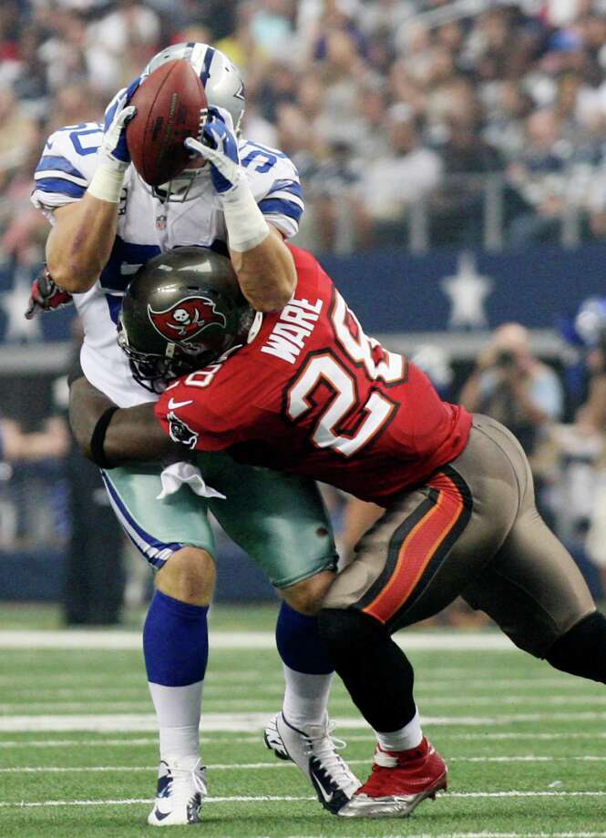 Dallas Cowboys's linebacker Sean Lee intercepts a pass as Tampa Bay Buccaneers' running back D.J. Ware tackles him during the first half at Cowboys Stadium in Arlington, Texas, Sunday Sept. 23, 2012. The interception led to the Cowboys' only touchdown of the game. They won 16-10. Photo: Jerry Lara, Express-News / © 2012 San Antonio Express-News