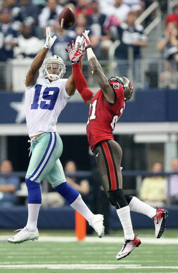 Dallas Cowboys's wide receiver Miles Austin reaches for a pass from Tony Romo as Tampa Bay Buccaneers' cornerback Eric Wright tries to break it up during the second half at Cowboys Stadium in Arlington, Texas, Sunday Sept. 23, 2012. The Cowboys won 16-10. Photo: Jerry Lara, Express-News / © 2012 San Antonio Express-News