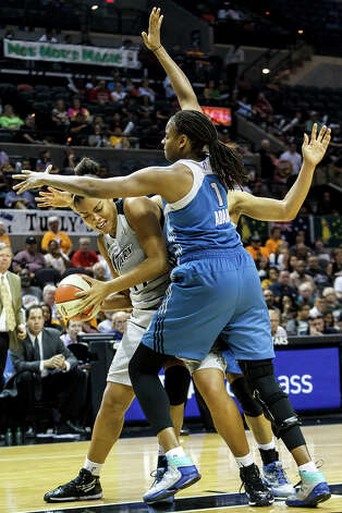 Silver Stars' Ziomara Morrison is doubled up under the basket by Minnesota's Jessica Adair (right) and Maya Moore during their game at the AT&T Center on Sept. 23, 2012. The Silver Stars came away with a 99-84 victory over the Lynx in their season finale. MARVIN PFEIFFER/ mpfeiffer@express-news.net MARVIN Photo: MARVIN PFEIFFER, Express-News / Express-News 2012