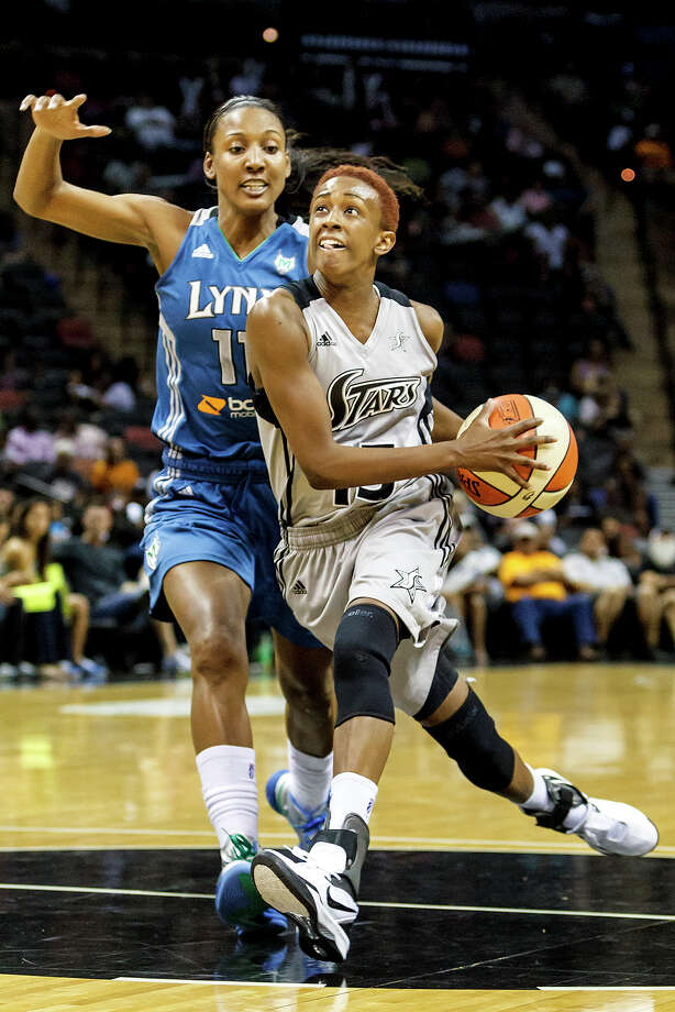 Silver Stars' point guard Danielle Robinson (right) drives to the basket past Minnesota's Candice Williams during the fourth quarter of their game at the AT&T Center on Sept. 23, 2012. The Silver Stars came away with a 99-84 victory over the Lynx in their season finale. MARVIN PFEIFFER/ mpfeiffer@express-news.net MARVIN Photo: MARVIN PFEIFFER, Express-News / Express-News 2012