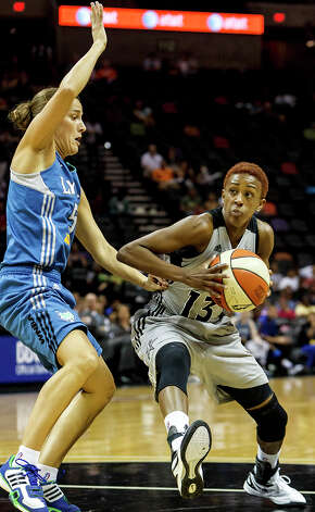 Silver Stars' point guard Danielle Robinson (right) looks to drive past Minnesota's Erin Thorn during the first quarterof their game at the AT&T Center on Sept. 23, 2012.  The Silver Stars came away with a 99-84 victory over the Lynx in their season finale.  MARVIN PFEIFFER/ mpfeiffer@express-news.net Photo: MARVIN PFEIFFER, Express-News / Express-News 2012